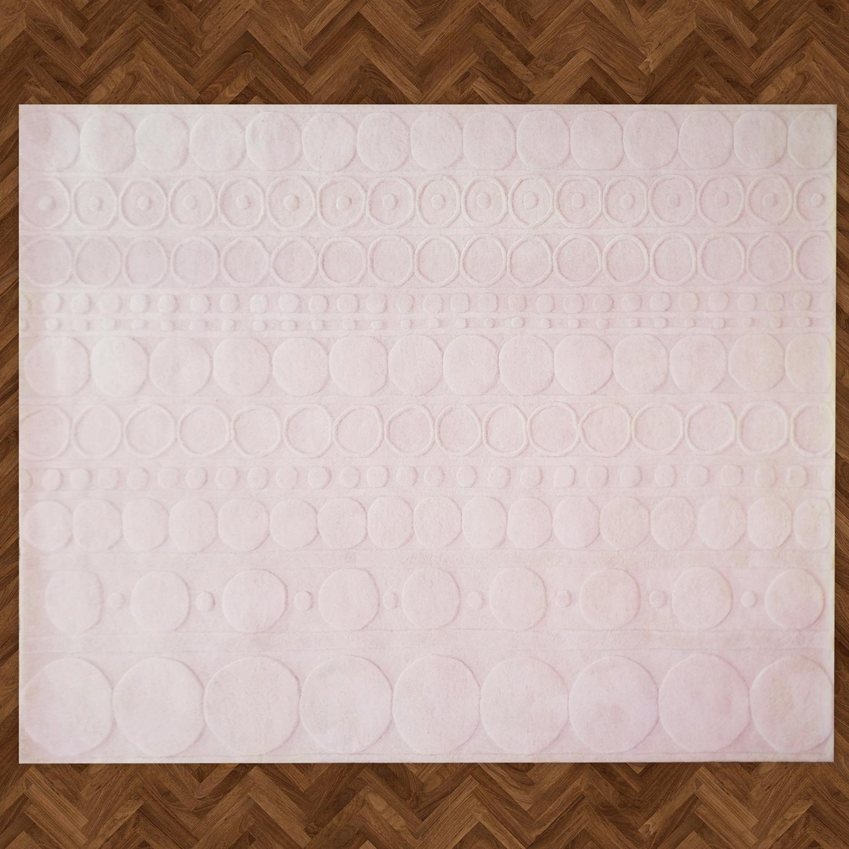 Varanasi Zeros é um modelo do tipo 'Hand-tufted' da linha Hometeka. A padronagem circular é obtida com alto-relevo dos pelos cortados à mão.